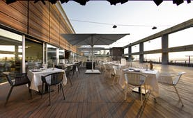 Parador de Cadiz Hotel Atlantico dining terrace, wooden decking, tables, chairs, sea views