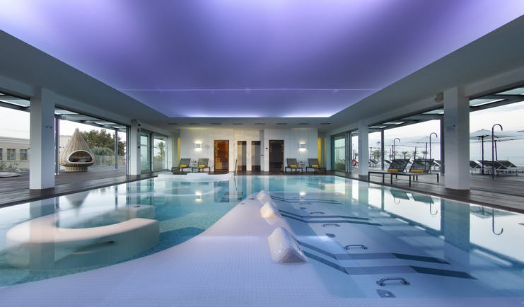 Parador de Cadiz Hotel Atlantico spa, indoor spa pool, decking leading to outdoor pool