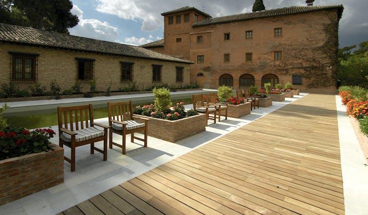 Parador de Granada exterior ancient building modern gardens walkway flowers