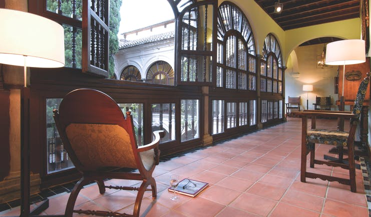 Parador de Granada hallway indoor seating floor tiles ornate windows