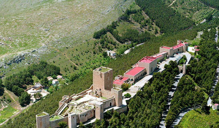 view of Parador de Jaen from above showing keep and castle walls