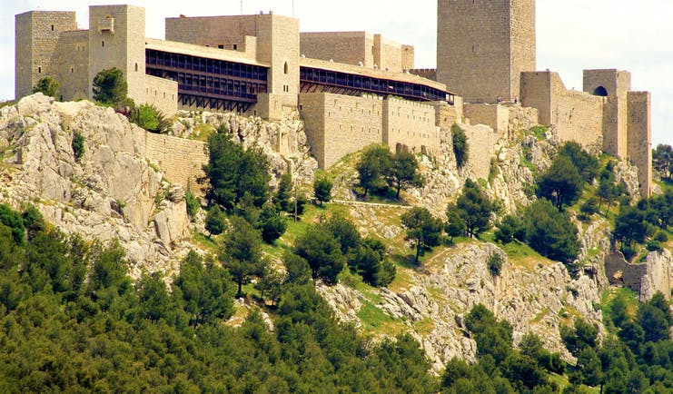 Castle walls with tower and keep on hilltop of the Parador de Jaen