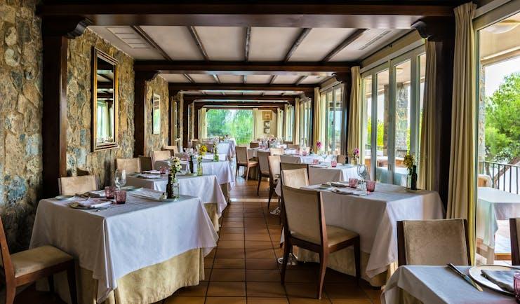 Parador de Malaga Gibralfaro restaurant, dining tables, chairs, traditional decor