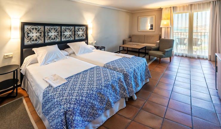 Parador de Malaga Gibralfaro standard room, tiled floor, doors leading to balcony
