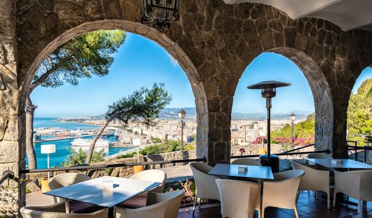 Parador de Malaga Gibralfaro terrace cafe, outdoor covered dining area, overlooking coast