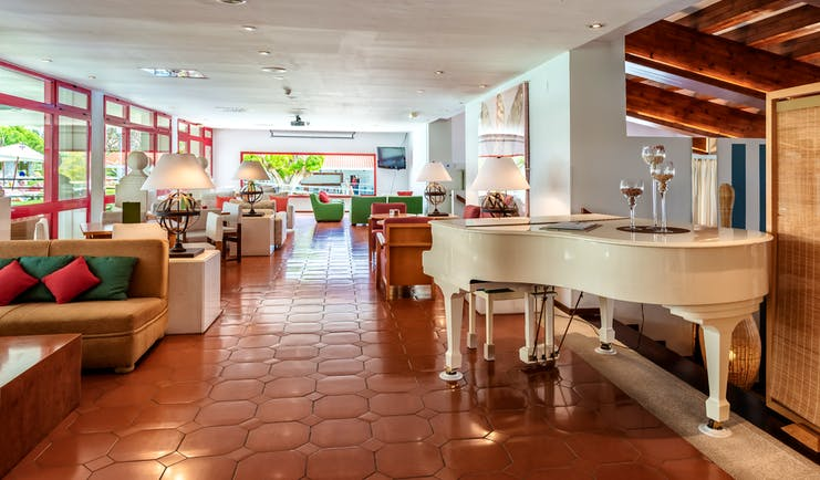 Parador de Nerja bar, baby grand piano, sofas, tiled floor