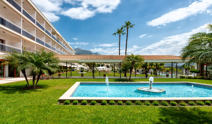 Parador de Nerja fountain, water feature, lawns, trees