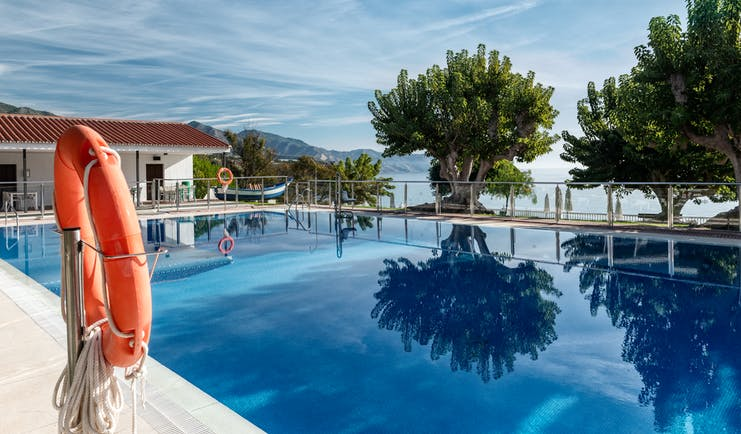 Parador de Nerja pool, lake and mountains in background