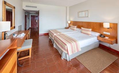 Parador de Nerja standard room, double beds, traditional decor