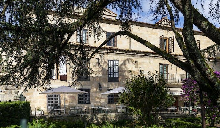 Parador de Pontevedra exterior, hotel building, outdoor terrace, trees, shrubs