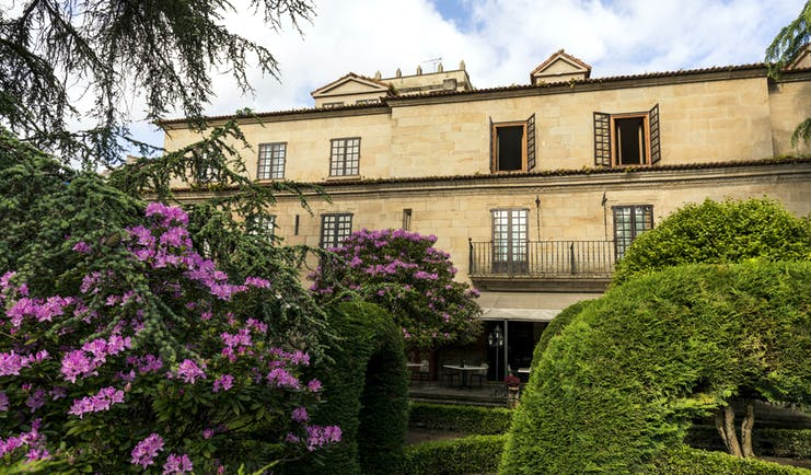 Parador de Pontevedra gardens, hotel building, traditional architecture, terrace, trees and shrubbery