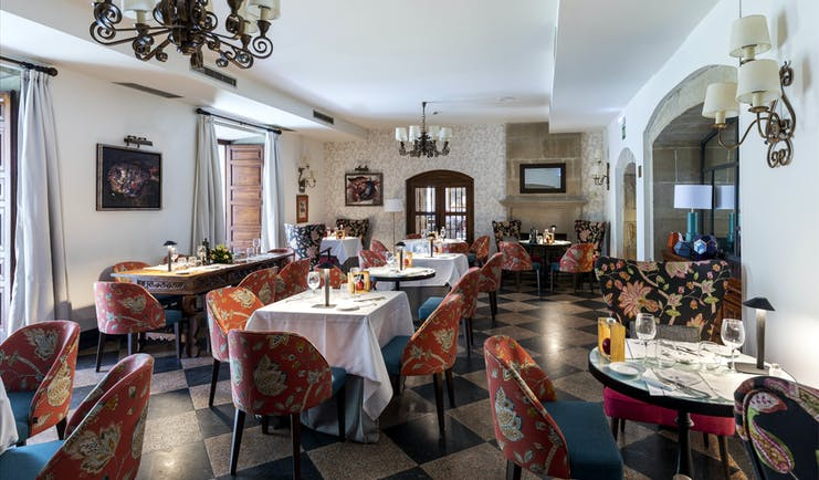 Parador de Pontevedra restaurant, tables, brightly coloured chairs, clean fresh decor