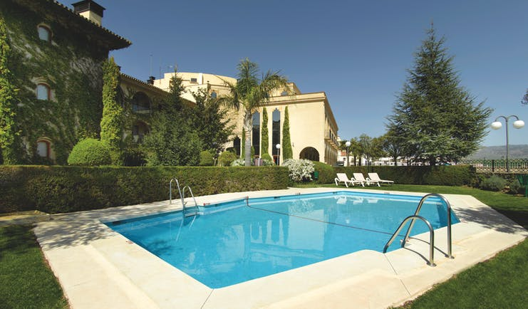 Parador de Ronda Andalucia pool sun loungers lawns