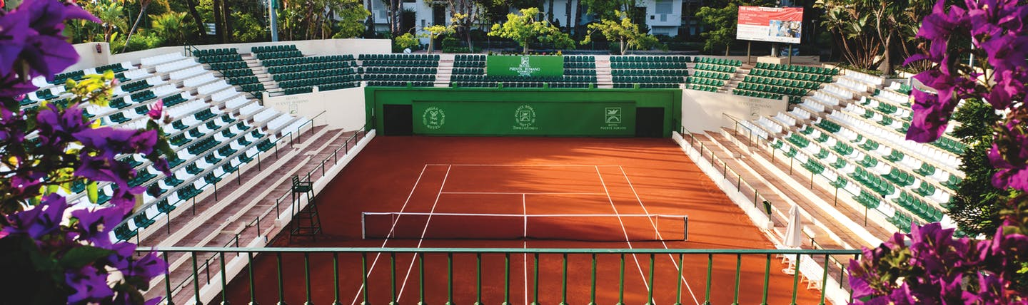 Hotel Puente Romano Marbella tennis court seating flowers