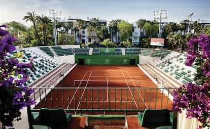 Hotel Puente Romano Marbella tennis court seating flowers