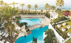 Puente Romano Marbella aerial shot of pools sun loungers beach in background