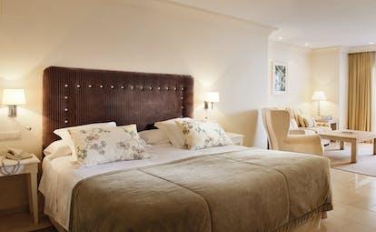 Puente Romano Marbella deluxe junior suite bed lounge area modern décor