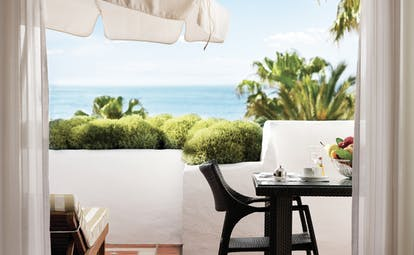 Puente Romano Marbella grand junior suite terrace private outdoor seating ocean views