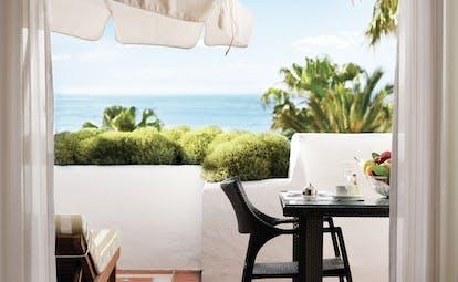 Puente Romano Marbella grand junior suite terrace private outdoor seating ocean views