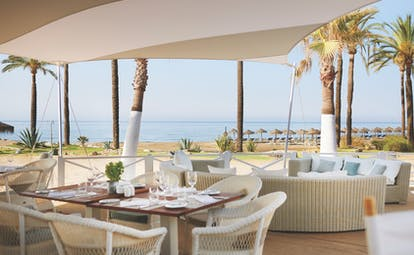 Puente Romano Marbella restaurant terrace outdoor dining sea views