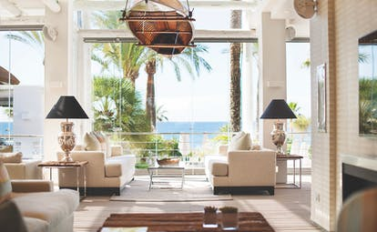 Puente Romano Marbella sea grill restaurant indoor dining sofas elegant décor
