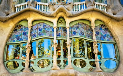 Modernist building in coloured glass and stone Casa Batilo by Gaudi in Barcelona