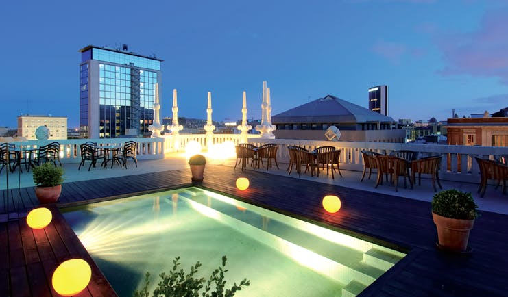 Hotel Casa Fuster Barcelona pool rooftop terrace at night city views