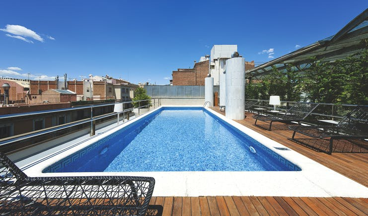 Hotel Claris Barcelona pool sun loungers views of city