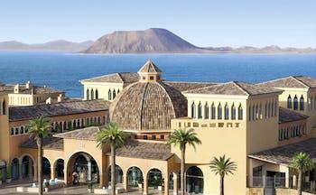 Gran Hotel Atlantis Bahia Fuerteventura exterior hotel buildings sea and island in background