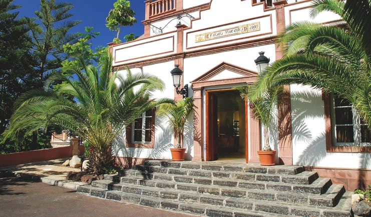Gran Hotel Bahia Del Duque Tenerife terrace restaurant white building with columns steps and palm trees