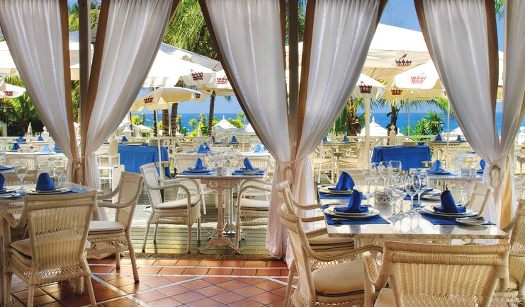 Gran Hotel Bahia Del Duque Tenerife restaurant with indoor and outdoor dining area and sea view