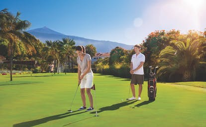 Hotel Botanico Tenerife golf couple playing golf