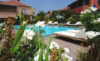 Hacienda de Abajo Canary Islands pool sun loungers flowers