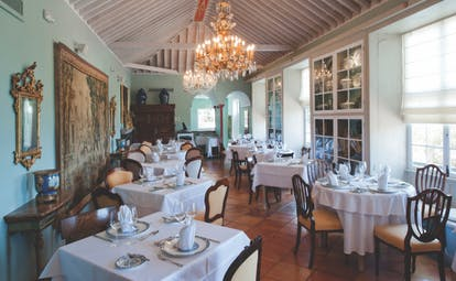 Hacienda de Abajo Canary Islands restaurant indoor dining area ornate décor chandelier artwork