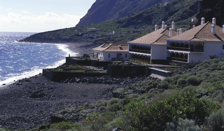 Parador de el Hierro Canary Islands beach hotel on secluded beach front mountains