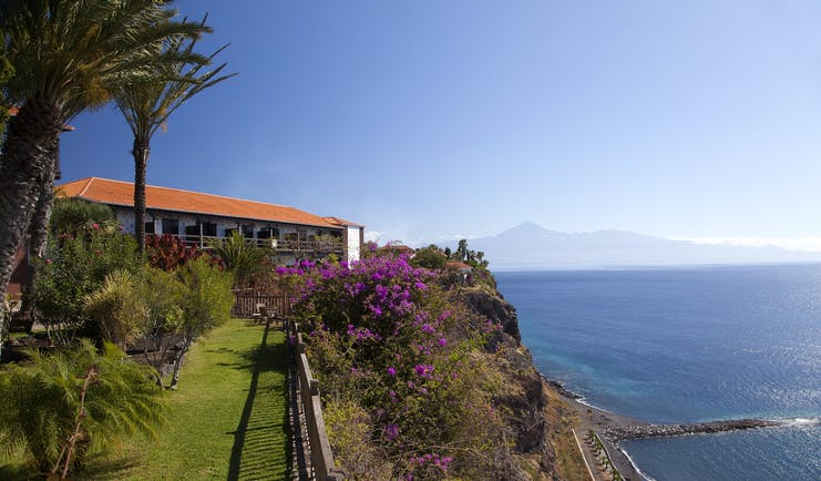 Parador de la Gomera Canary Islands gardens lawn trees flowers overlooking coastline and sea