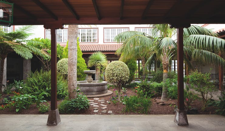 Courtyard with gardens and fountain inside the hotel