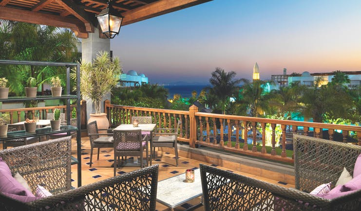 Princesa Yaiza bar terrace, covered seating area with views over the resort, wicker furniture