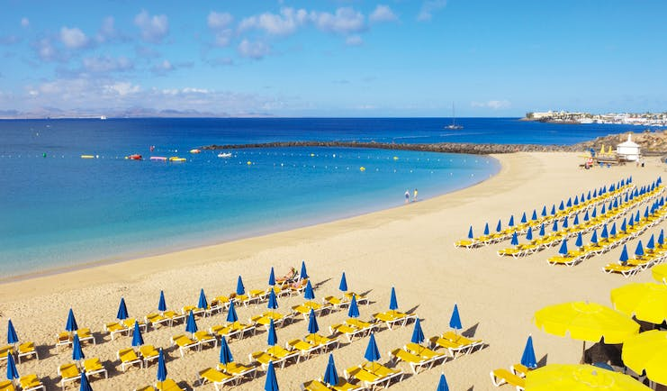 Princesa Yaiza beach, golden sand, blue sea, sun loungers, umbrellas