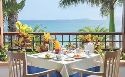 Princesa Yaiza table on private balcony set for breakfast, views over the sea