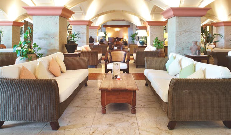 Princesa Yaiza piano bar, indoor seating area, sofas, armchairs, marble floors, elegant decor