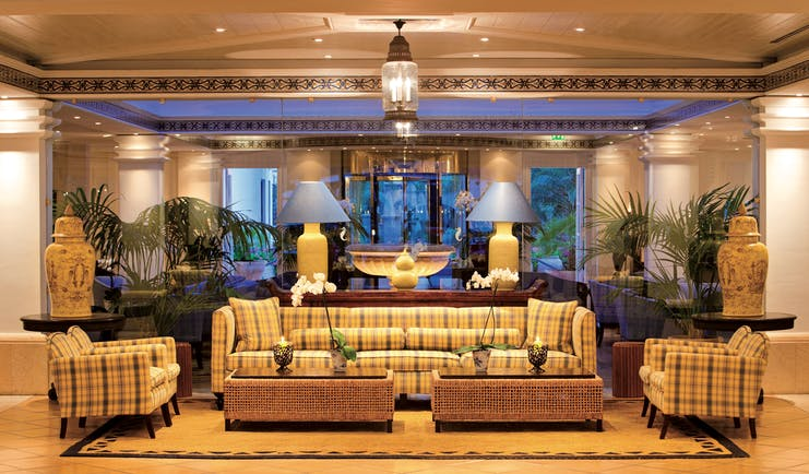 Seaside Grand Hotel Residencia Canary Islands lobby cosy décor sofas armchairs