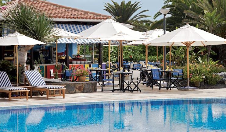 Seaside Grand Hotel Residencia Canary Islands pool side bar sun loungers