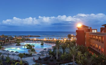 Sheraton Fuerteventura Canary Islands pools at night sea in background palm trees
