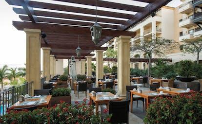 La Plantacion del Sur Tenerife outdoor dining area trees red flowers