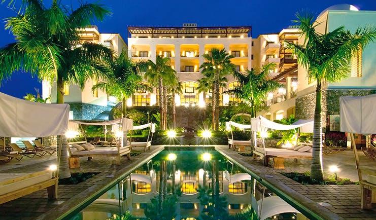 La Plantacion del Sur Tenerife exterior at night pool hotel lit up canopied sun loungers