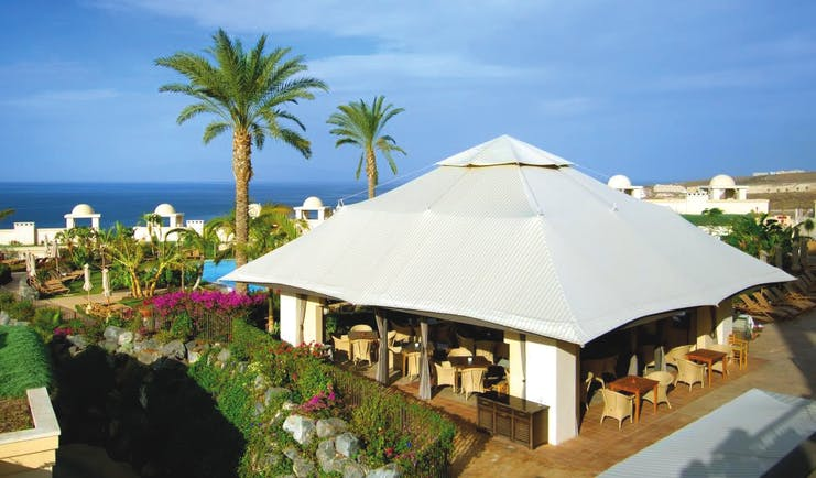 La Plantacion del Sur Tenerife pool bar and restaurant covered outdoor dining area poolside