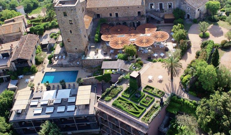 Castell D'Emporda Eastern Spain aerial shot hotel building pool gardens