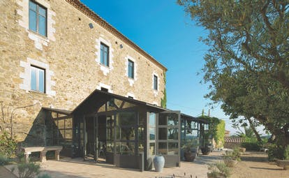 Castell D'Emporda Eastern Spain restaurant exterior patio gardens trees