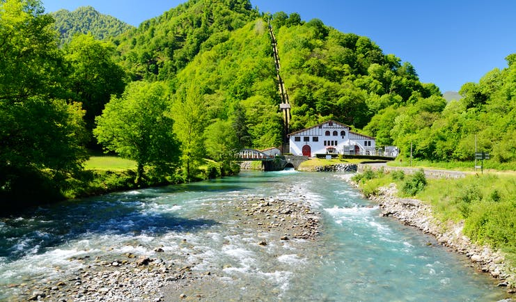 Mountain river with small half timebered house in the Spanish Pyrenees